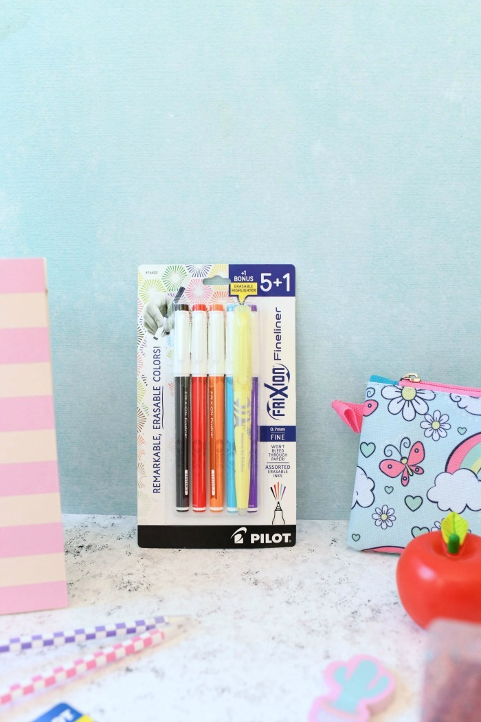 Fineliners in package against blue wall.