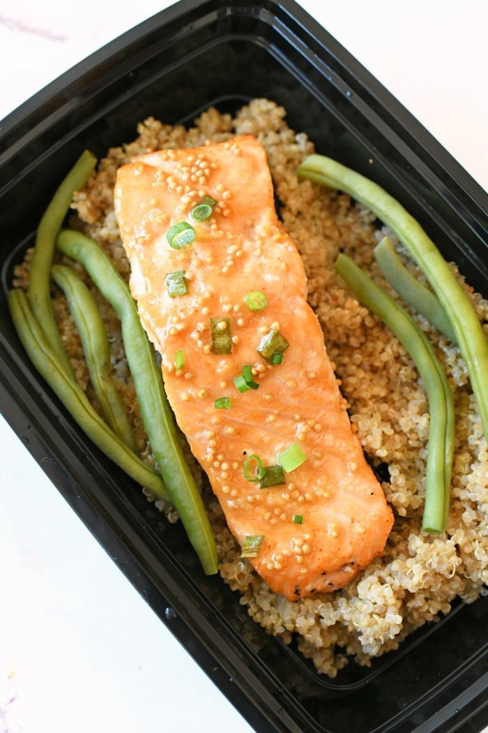 Honey Mustard Salmon in a meal prep container.