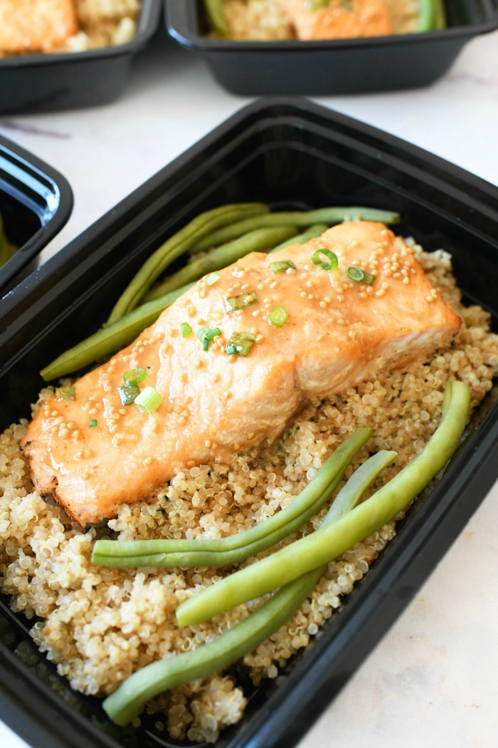 Honey mustard grilled salmon in meal prep container.