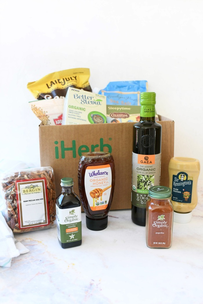 Iherb Grocery Haul in box on white table.