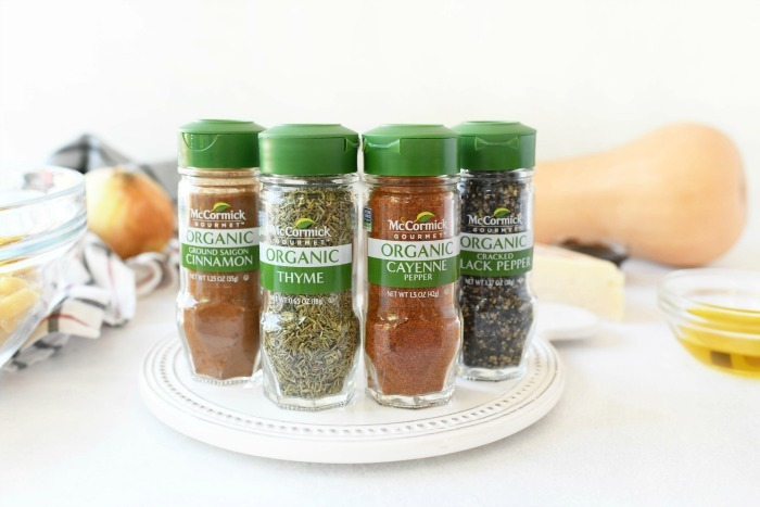 McCormick Organic Spices on white table.