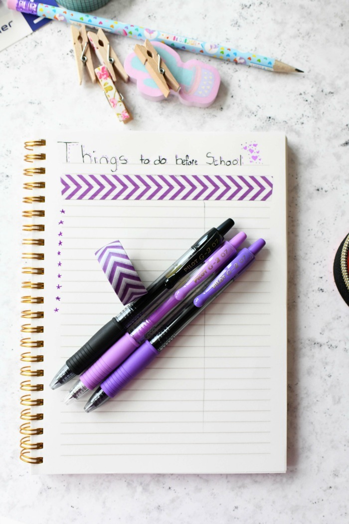 purple and black Pilot pens with purple themed bullet journal.