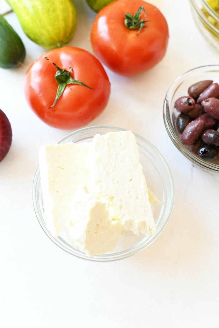 fresh feta cheese ingredients on white table.