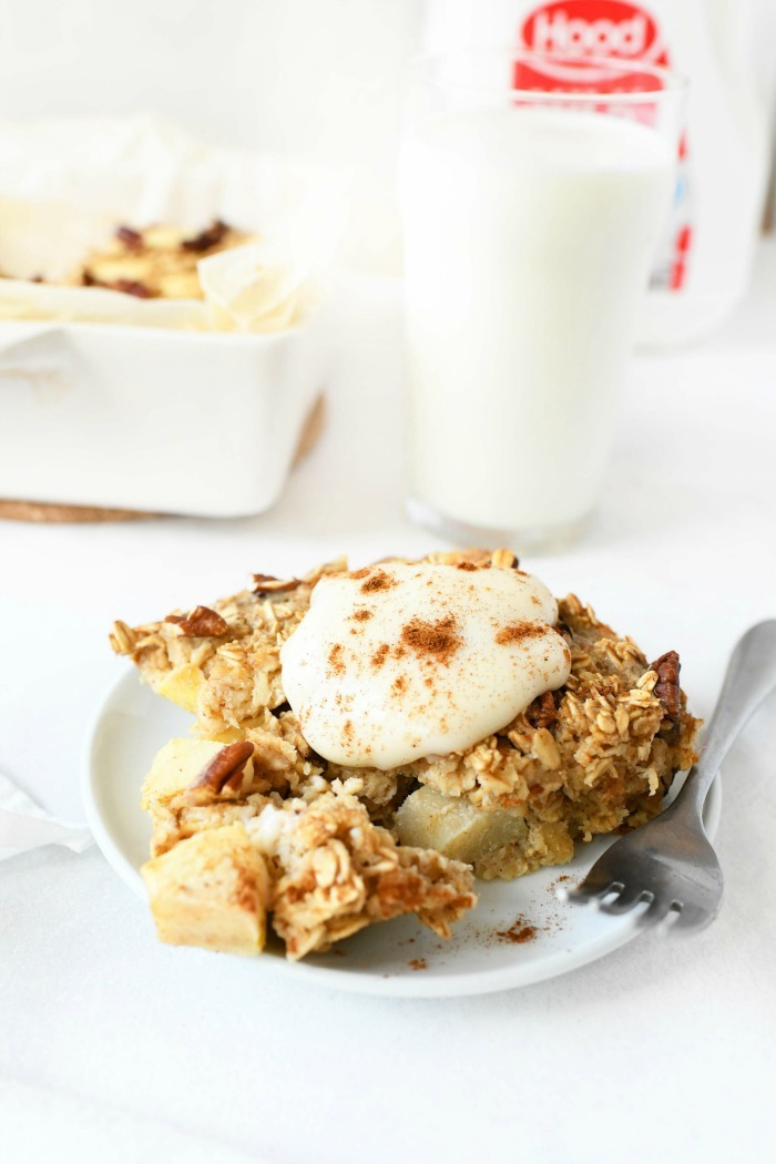 Baked apple oatmeal on plate with yogurt served on top.