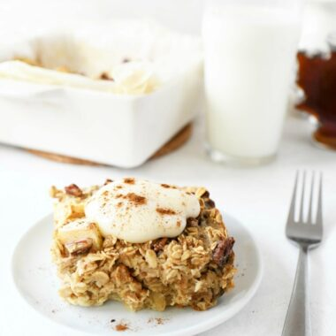 Baked Apple oatmeal with yogurt on top on a plate.