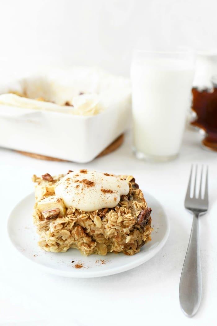 Baked Apple oatmeal with yogurt on top on a plate.