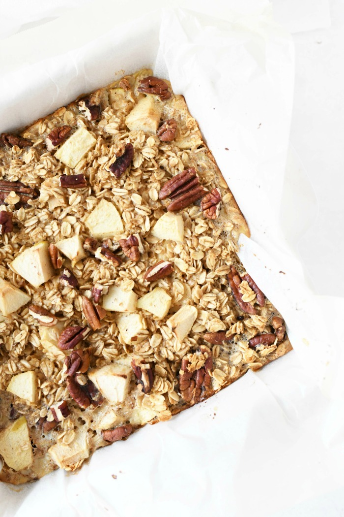 Baked Apple pecan oatmeal baked in a white dish.