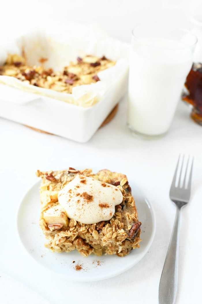Baked apple pie oatmeal with yogurt on top.