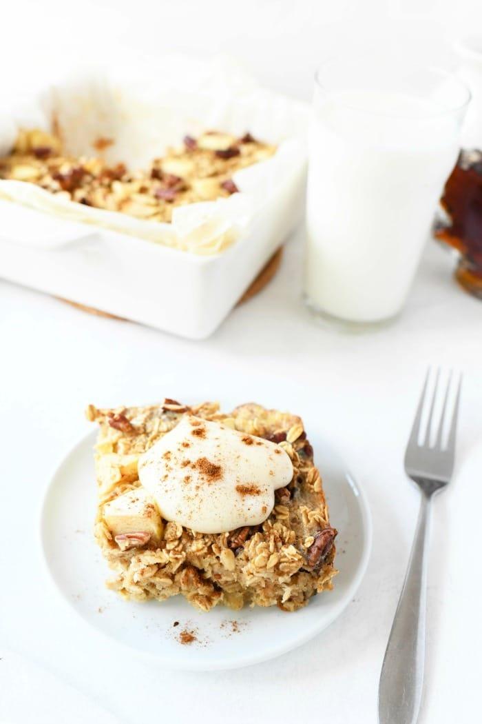 Baked apple pie oatmeal with yogurt on top.