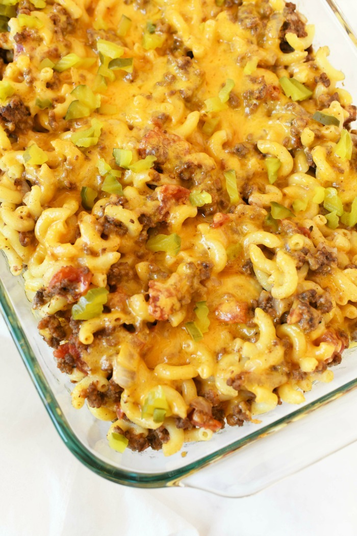 Cheeseburger casserole pasta baked with cheese in a glass pan.