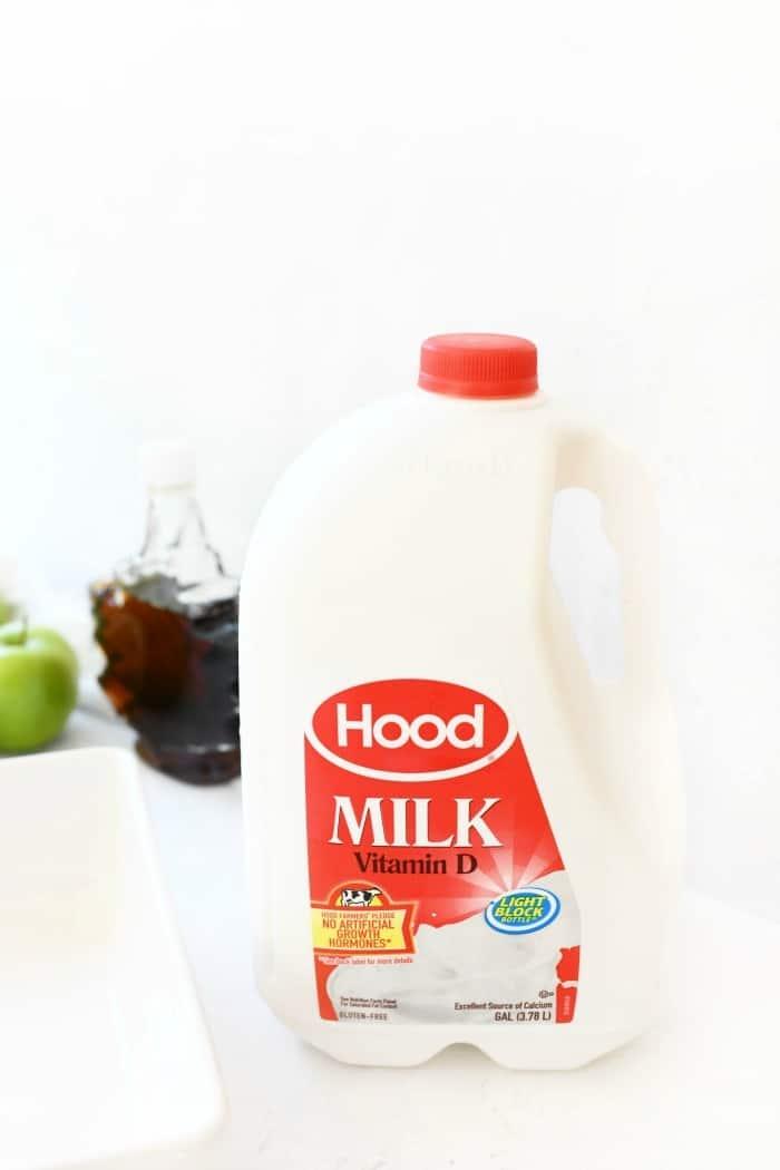 Hood Whole Milk gallon on white table.