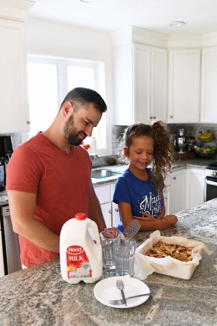 Hood milk on counter with a father and daughter near it.