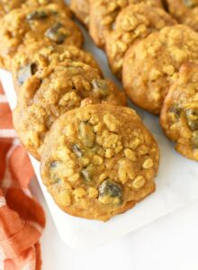 Pumpkin oatmeal cookies on a white tray up close.