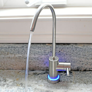 reverse osmosis water faucet with water flowing from it
