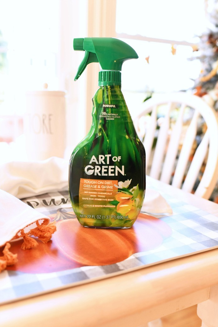Art of Green Spray bottle on a fall themed table.