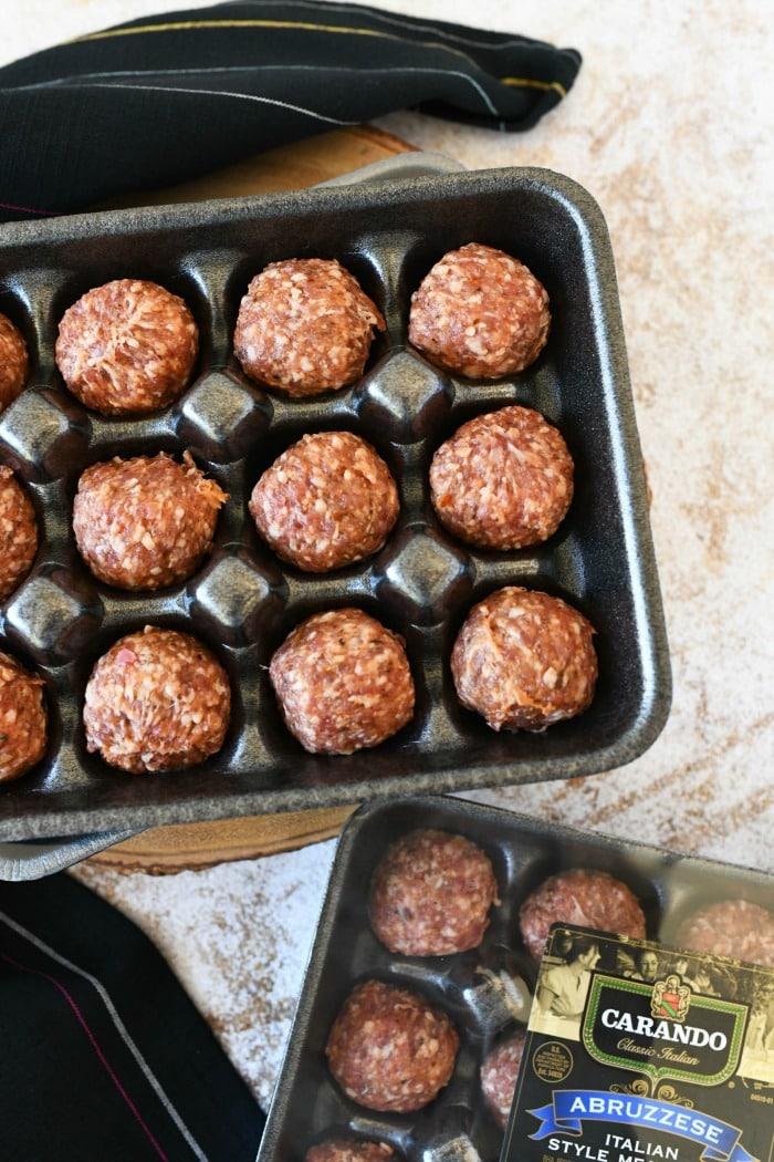 Carando Abruzzese meatballs uncovered with a black napkin.