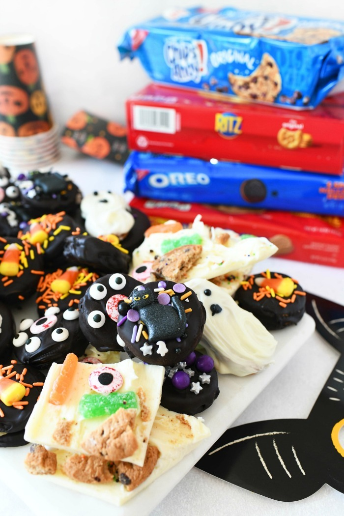 Halloween Cookie Ideas on a white tray with cookie boxes in the background.