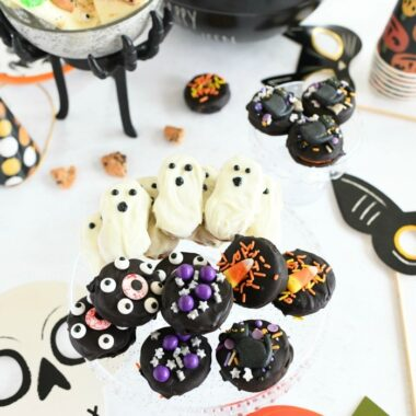 Halloween party snacks on a white table.