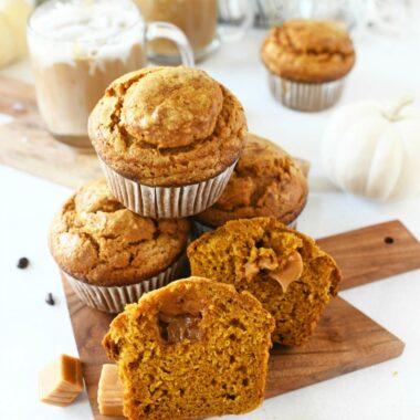 Jumbo Caramel Pumpkin Muffins on a mini wood cutting board.