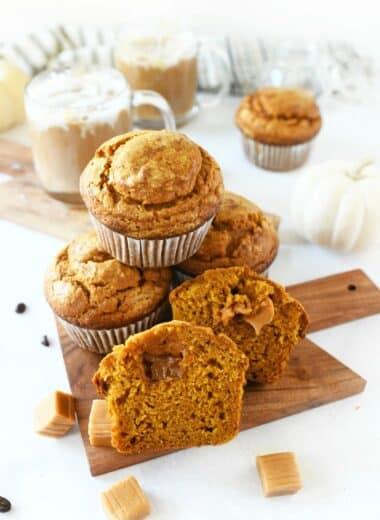 Jumbo Caramel Pumpkin Muffins on a mini wood cutting board.