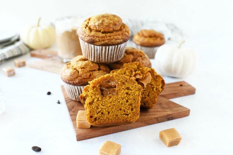 Jumbo Pumpkin Caramel Muffins on a mini wooden cutting board.