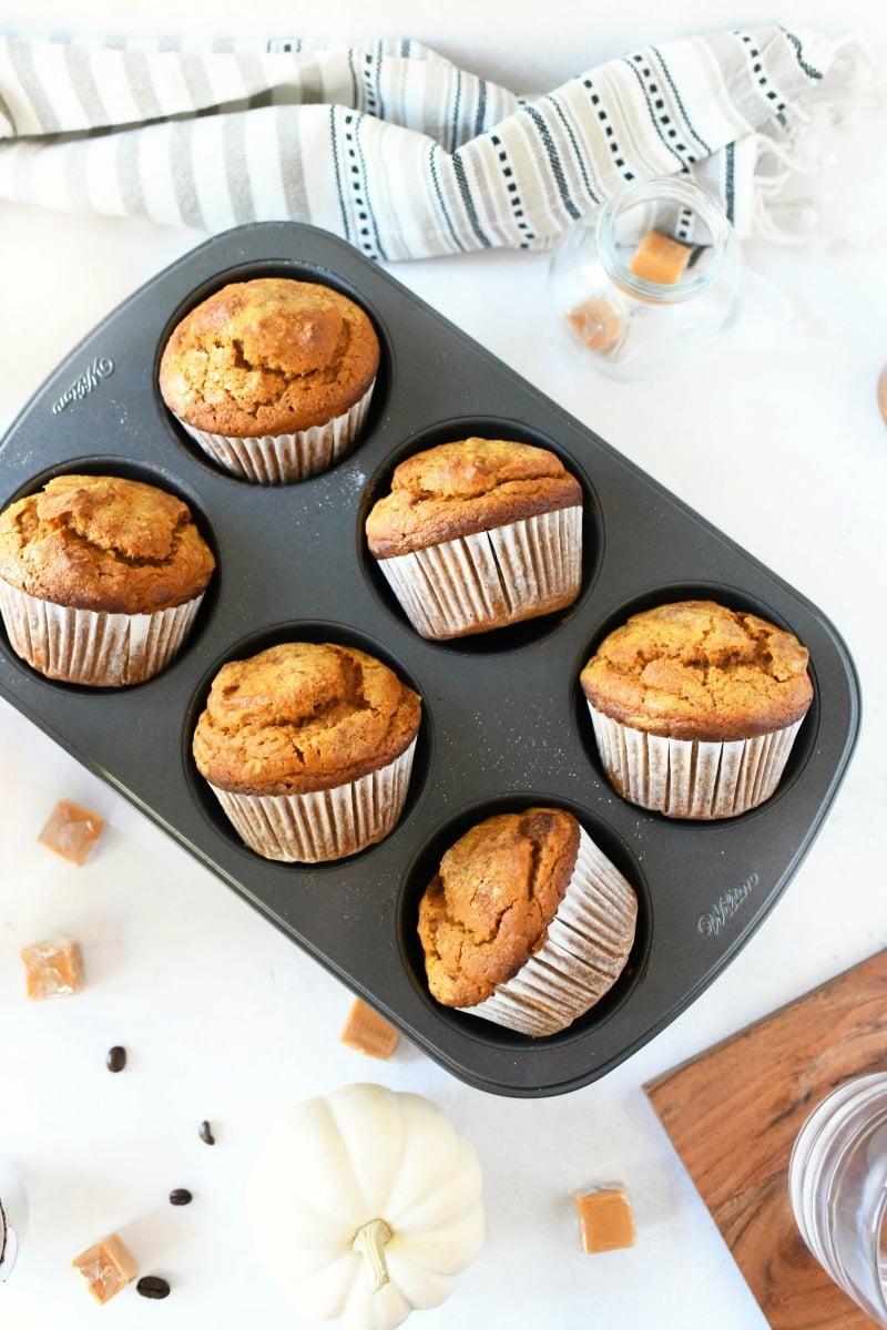 Jumbo pumpkin caramel muffins in a muffin tin.