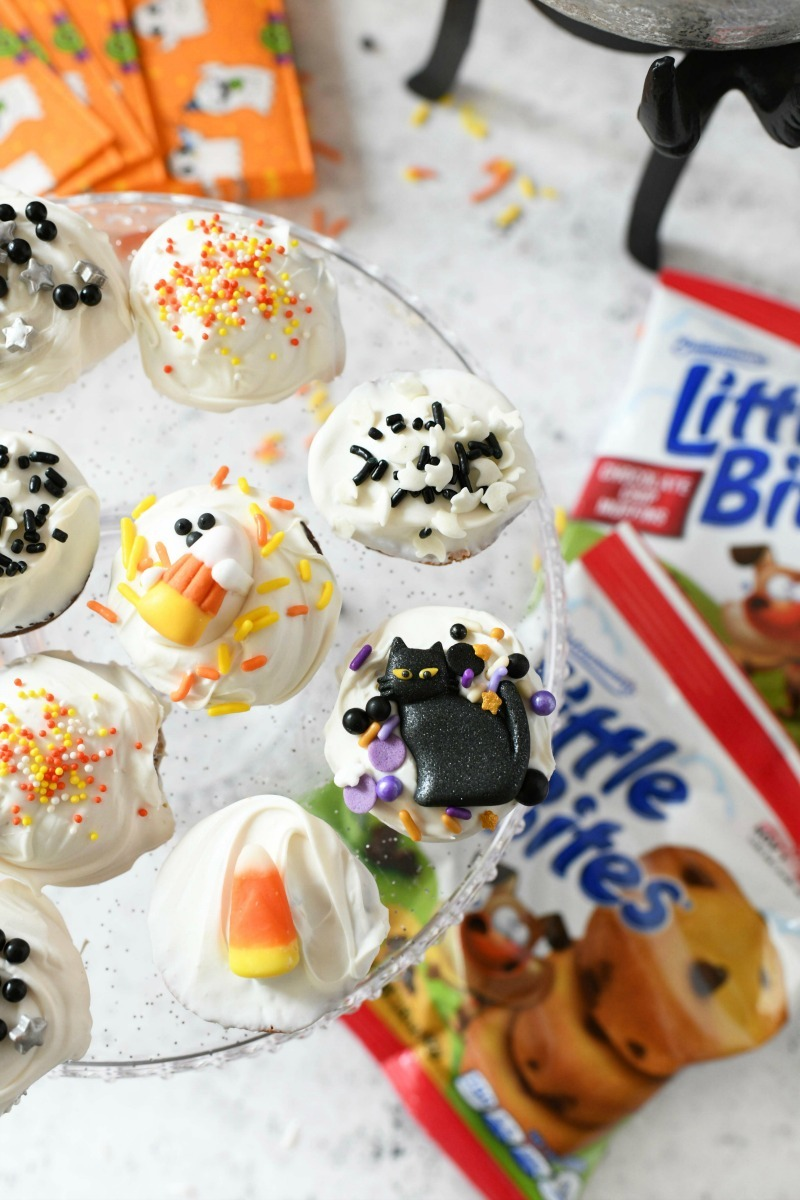 Little Bites Halloween snacks on a clear cake stand.