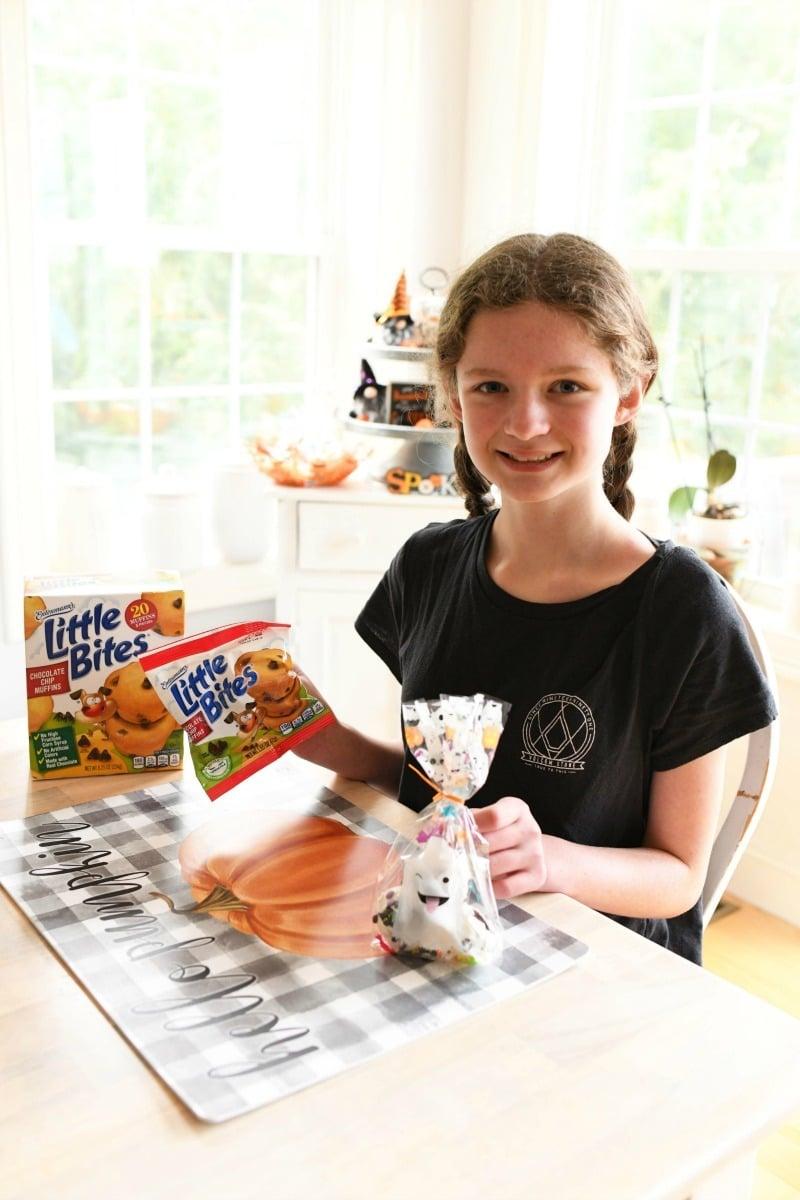 Girl enjoying Little Bites Muffins.