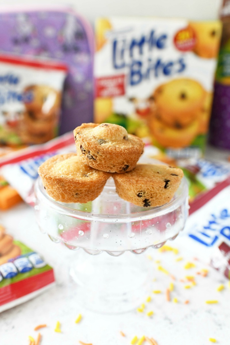 Little Bites chocolate chip muffins on a mini, clear cake stand.