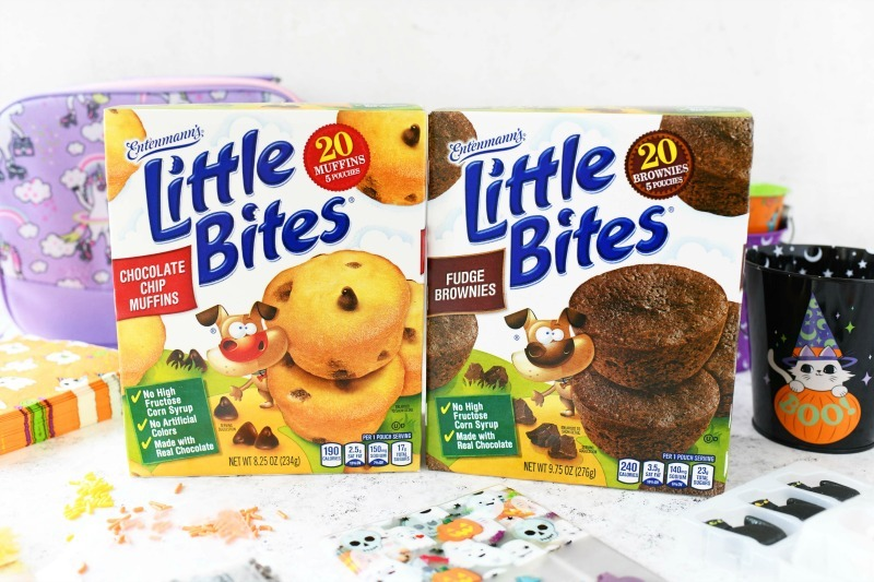 Little Bites mini muffins boxes on a grey table.