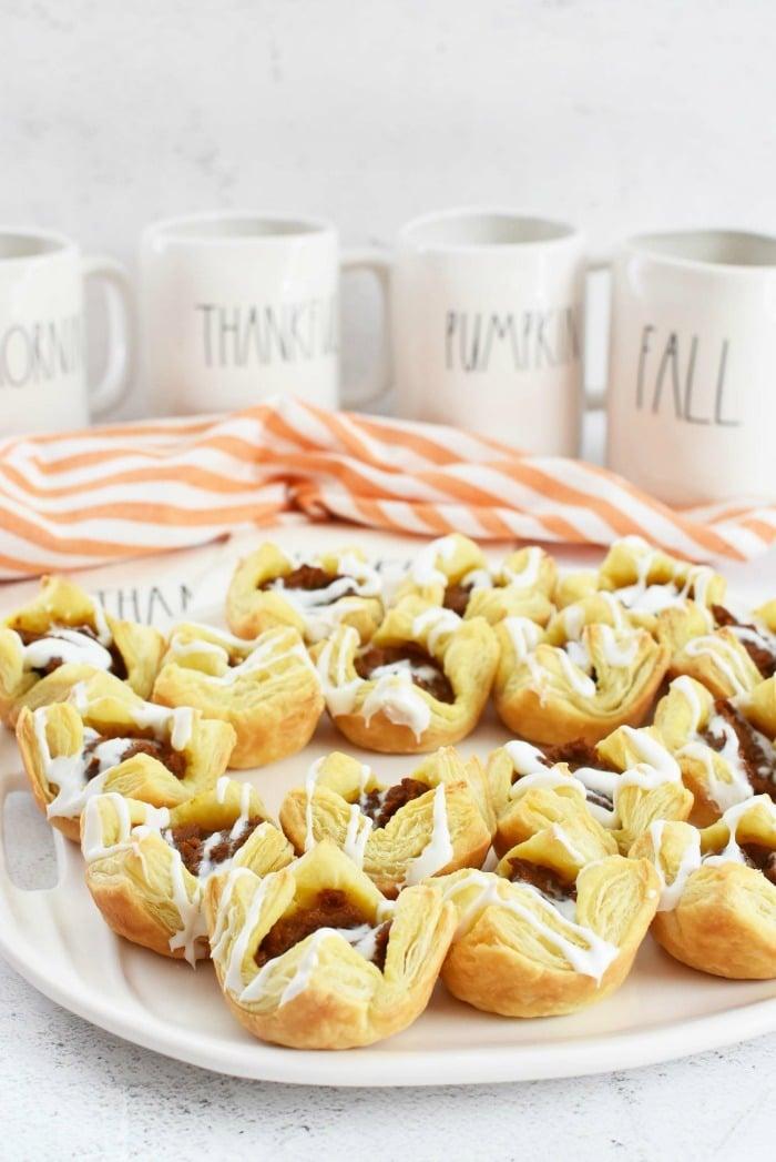 Mini Pumpkin Pie Puff Pastry Bites near Rae Dunn fall mugs.
