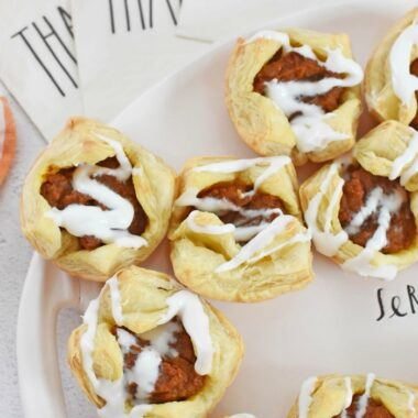 Pumpkin pie puff pastries near Rae Dunn thankful napkins.