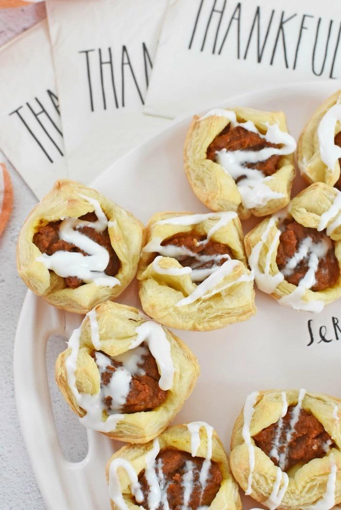 Pumpkin pie puff pastries near Rae Dunn thankful napkins.