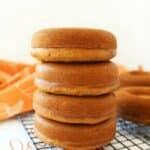 Soft Pumpkin donuts in a stack.