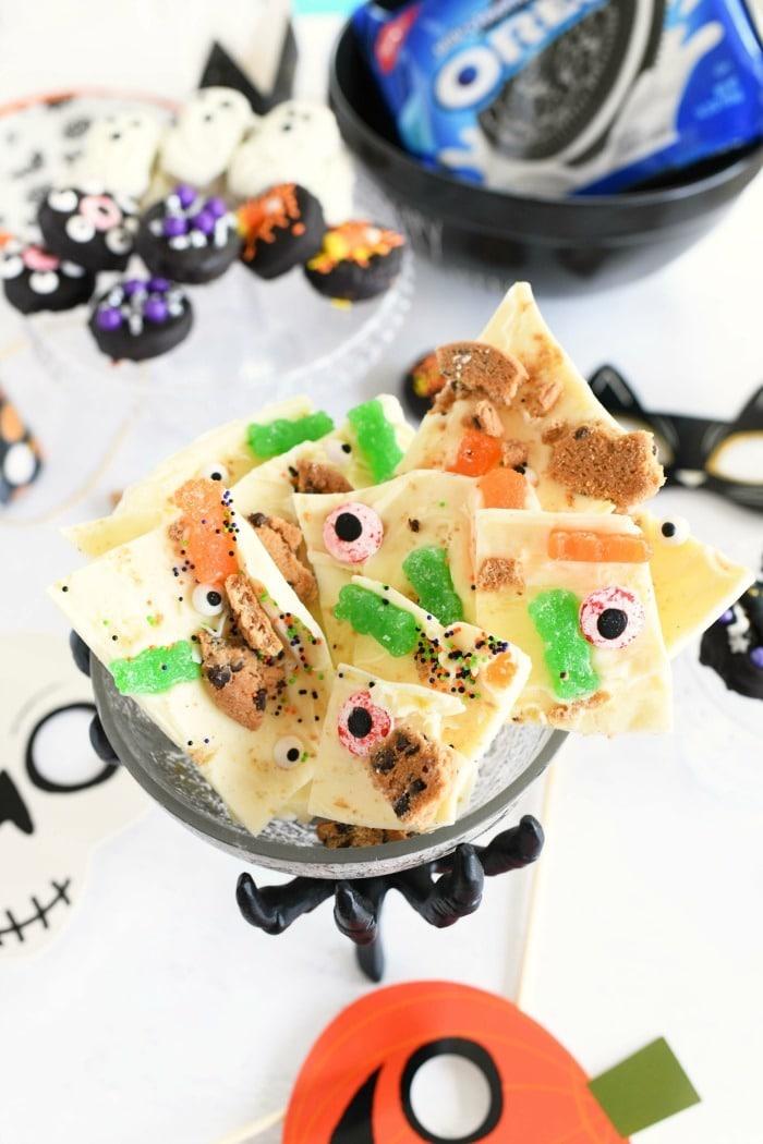 Halloween Zombie chocolate bark in a creepy dish on a Halloween themed table.