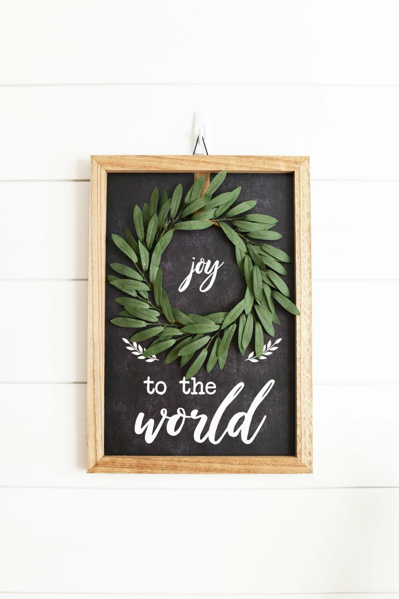 Joy to the World Farmhouse wall art on white shiplapped walls.