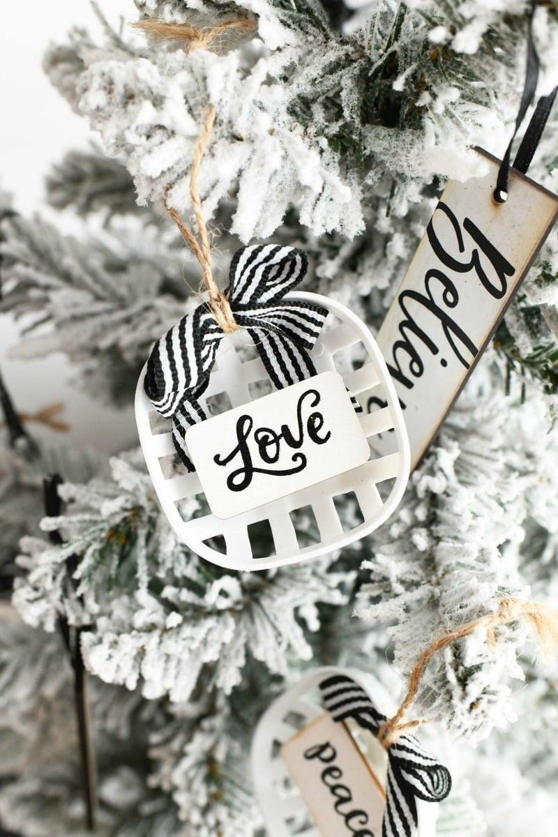Love Farmhouse Ornament on a tree.