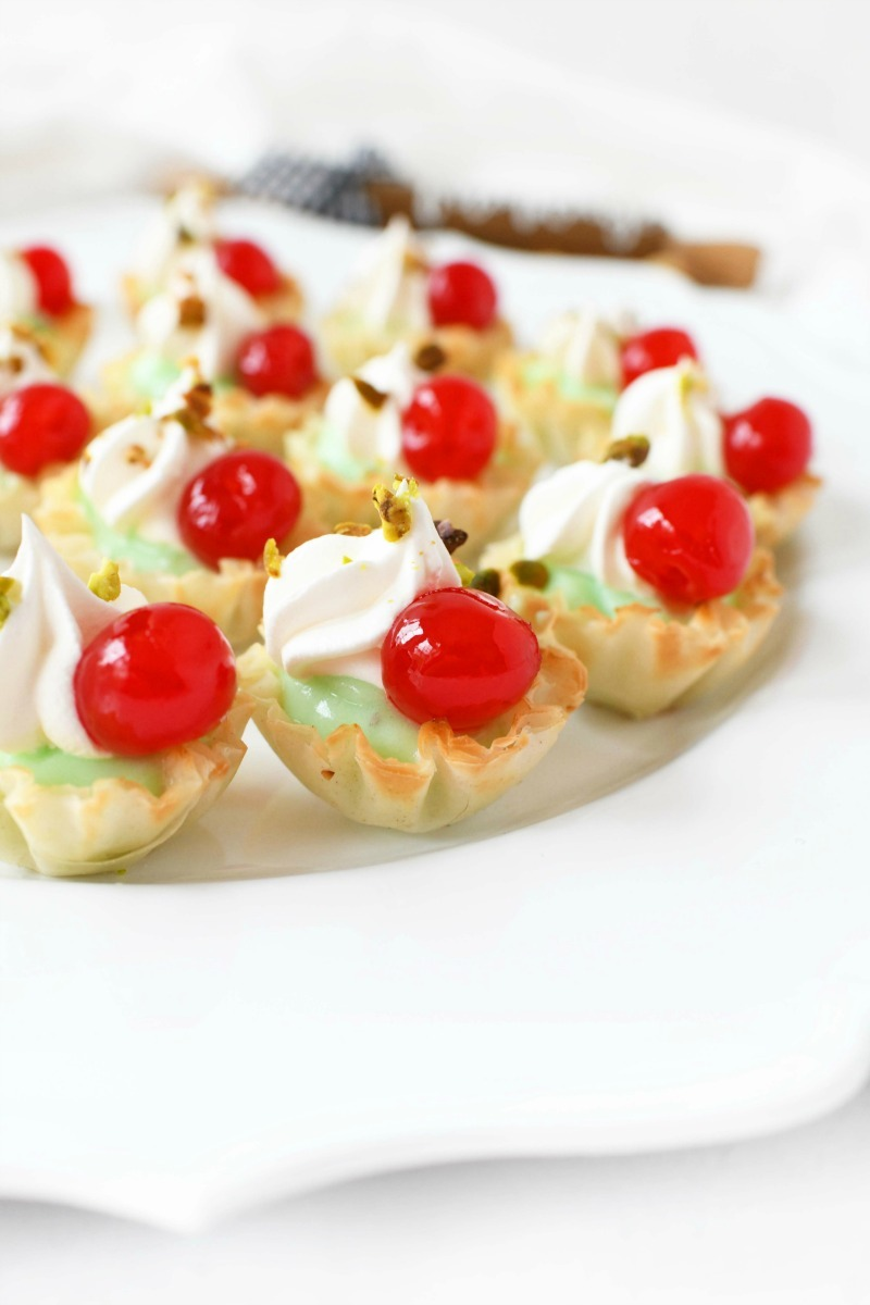 Pistachio Cherry Bites on a white tray.