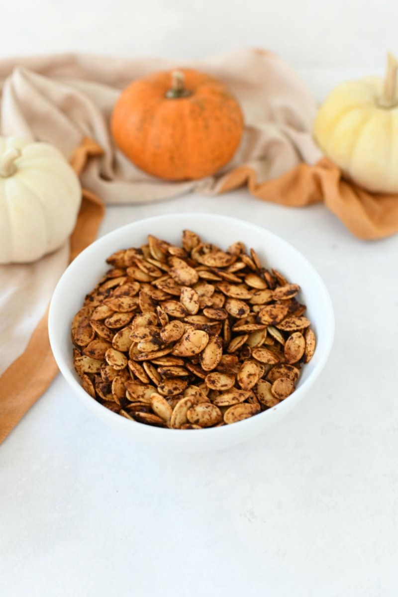 Portuguese Baked Pumpkin Seeds in a white bowl.