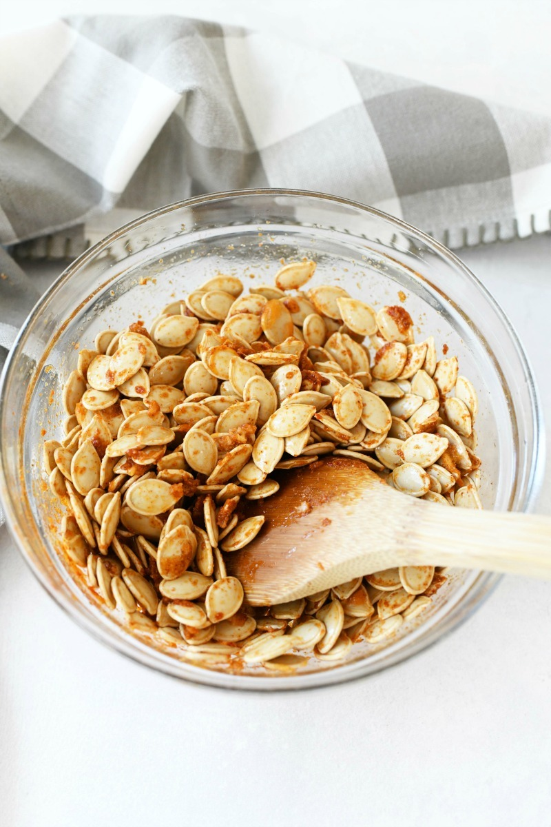Spicy Portuguese Pumpkin Seeds unbaked in a glass bowl.