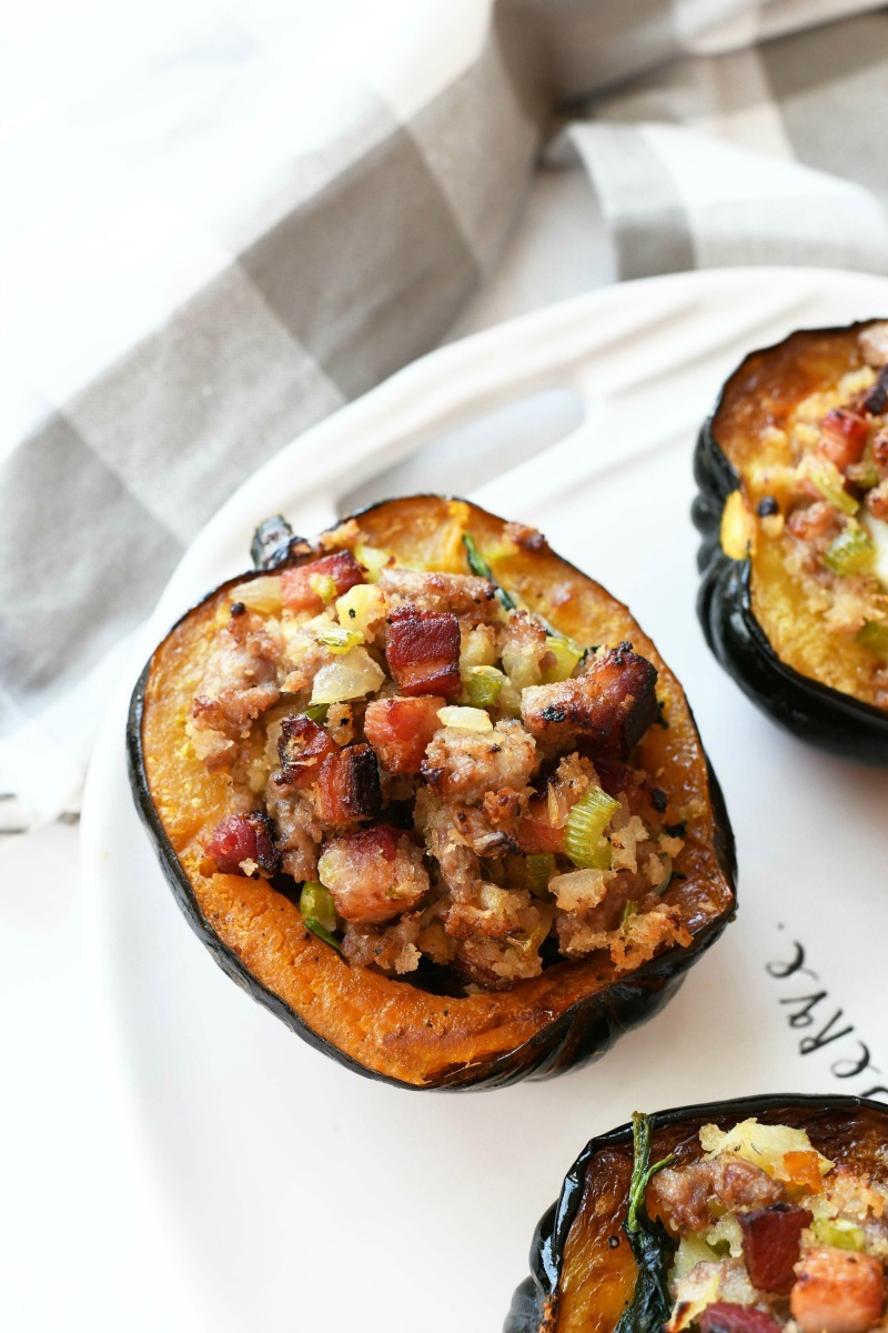 Bacon Acorn Squash on a white tray with a gray checkered napkin.