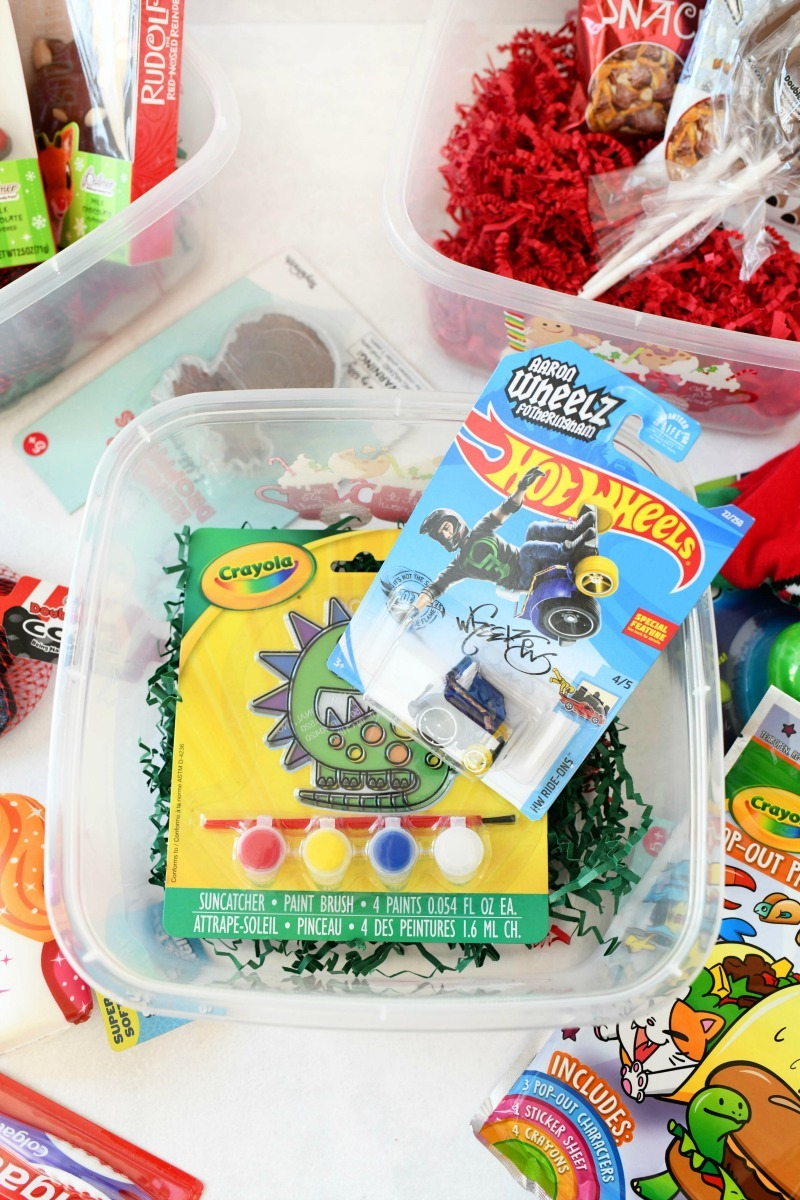 Inexpensive Boy's gift idea with toys in a plastic box for a cheap gift.