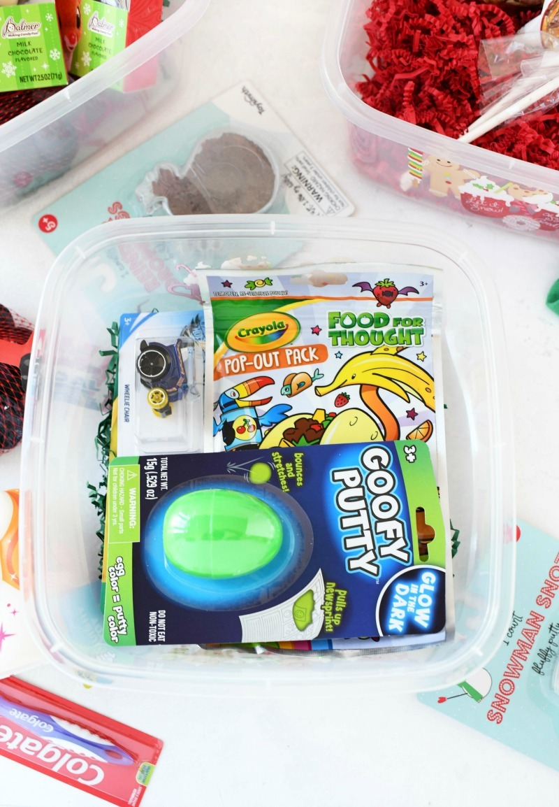 Boy's Christmas Gift Box with toys on a white table.