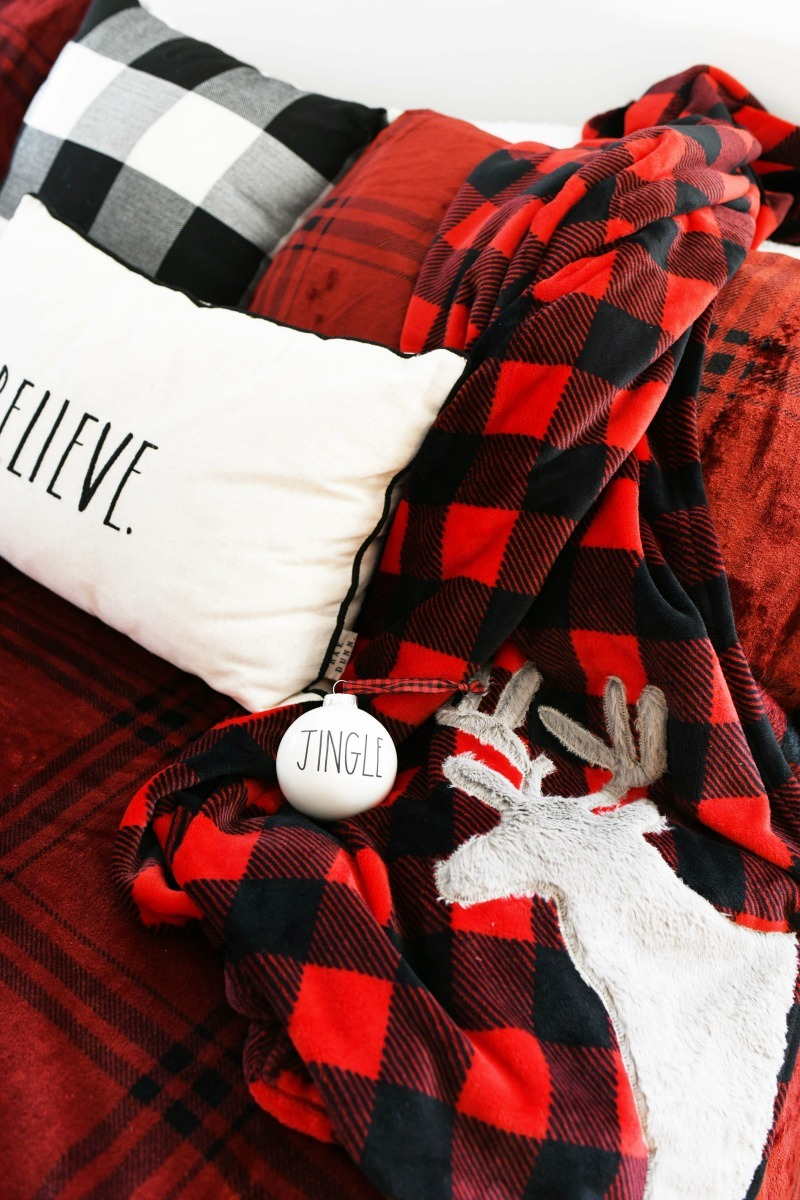Buffalo Plaid Red Bedding on a king sized bed.