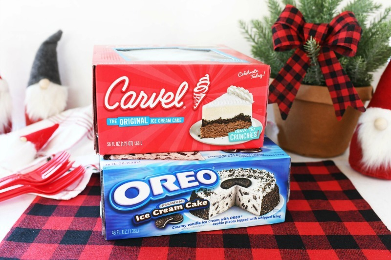Carvel & OREO ice cream cakes in boxes on a holiday decorated table.