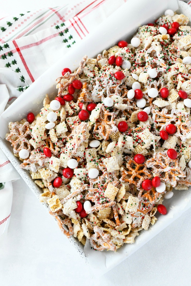 Christmas Crack Chex Snack Mix in a white baking tray.