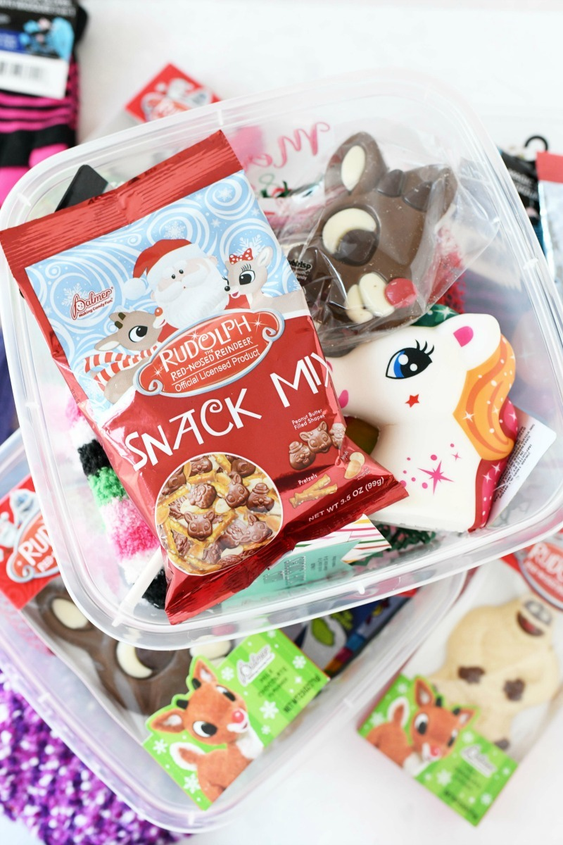 Dollar Store Gift Box filled with snacks and trinkets for Christmas gifting.