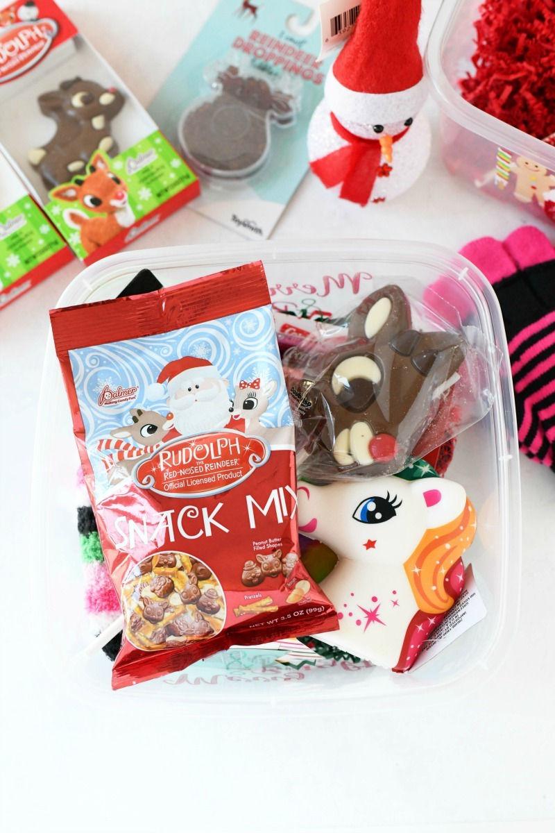 Dollar Store gift idea is a box filled with small trinkets and candies.