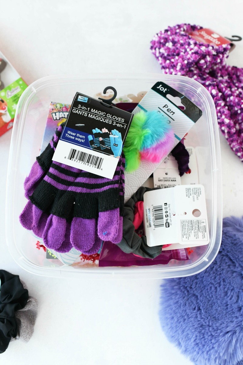Dollar store gift boxes with purple gloves and rainbow pen inside.
