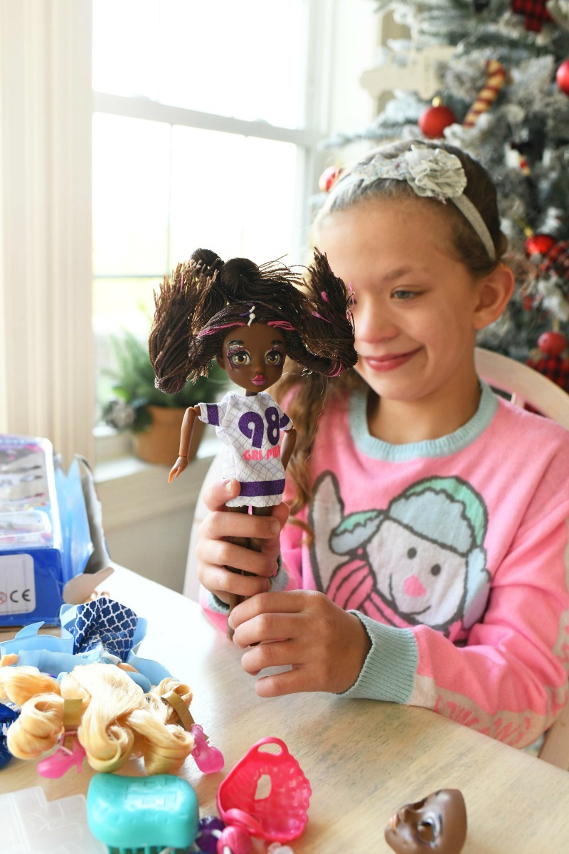 African American FailFix doll in girls hand.